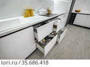 Luxurious white and black modern kitchen interior, drawers pulled out. Стоковое фото, фотограф Сергей Старуш / Фотобанк Лори