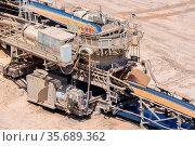 Brown coal open pit landscape with machinery conveyor belt in Garzweiler... Стоковое фото, фотограф Zoonar.com/T.W. van Urk / age Fotostock / Фотобанк Лори