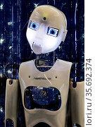 Fotomontage, der humanoide Roboter RoboThespian mit weltallaehnlichen... Стоковое фото, фотограф Zoonar.com/Stefan Ziese / age Fotostock / Фотобанк Лори