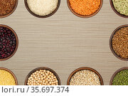 Background - bowls with various grains and beans form a frame. Стоковое фото, фотограф Евгений Харитонов / Фотобанк Лори