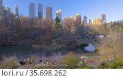 People enjoy sunny autumn day in New York Central park. Стоковое видео, видеограф Sergey Borisov / Фотобанк Лори