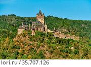 Beautiful Reichsburg castle on a hill in Cochem town, Germany. Стоковое фото, фотограф Zoonar.com/NIKOLAY OKHITIN / easy Fotostock / Фотобанк Лори