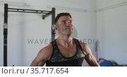 Fit caucasian man training, exercising, lifting weights inside gym. Стоковое видео, агентство Wavebreak Media / Фотобанк Лори