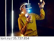 Male gamer using virtual reality headset. Стоковое фото, фотограф Tryapitsyn Sergiy / Фотобанк Лори