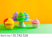 Sweet cupcakes, variaty of colours is available. Стоковое фото, фотограф Zoonar.com/Oksana Shufrych / easy Fotostock / Фотобанк Лори