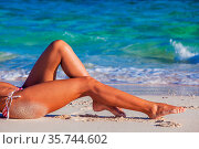 Women's sexy legs on the beach travel tropical vacation. Стоковое фото, фотограф Zoonar.com/Ivan Mikhaylov / easy Fotostock / Фотобанк Лори
