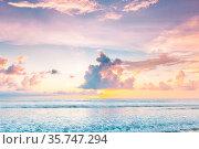 Morning seascape, beautiful sunrise in cloudy sky over the sea. Стоковое фото, фотограф Zoonar.com/Ivan Mikhaylov / easy Fotostock / Фотобанк Лори