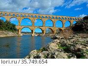 The Ancient Roman Pont du Gard aqueduct and viaduct bridge over the... Стоковое фото, фотограф Neil Harrison / age Fotostock / Фотобанк Лори
