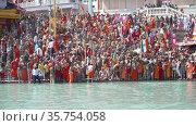 Kumbh Mela Haridwar India. Slowmotion shot of Devotees, Sadhus, Akharas taking bath in Holy Water of River Ganges. Appleprores 422 Cinetone. Редакционное видео, видеограф Devendra Rawat / Фотобанк Лори