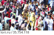 Kumbh Mela Haridwar India. Slowmotion shot of Kinnar Akhara Sadhus taking bath in Holy Water of River Ganges. Appleprores 422 Cinetone. Редакционное видео, видеограф Devendra Rawat / Фотобанк Лори