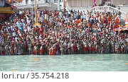Kumbh Mela Haridwar India. Sadhus or Saints of Akharas worshipping Holy Ganges or Ganga river. Appleprores 422 Cinetone 60fps. Редакционное видео, видеограф Devendra Rawat / Фотобанк Лори