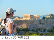 Enjoying vacation in Greece. Young traveling woman enjoying view of Athens city and Acropolis. (2019 год). Стоковое фото, фотограф Константин Лабунский / Фотобанк Лори