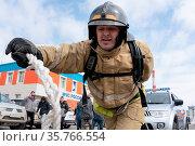 PETROPAVLOVSK CITY, KAMCHATKA PENINSULA, RUSSIA - APR 19, 2019: Firefighter... Стоковое фото, фотограф Zoonar.com/Alexander A. Piragis / age Fotostock / Фотобанк Лори