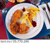 Crisp chicken nuggets with golden brown crust and french fries. Стоковое фото, фотограф Яков Филимонов / Фотобанк Лори