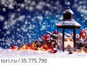 Burning candles , lantern and christmas decoration on magic bokeh... Стоковое фото, фотограф Zoonar.com/Ivan Mikhaylov / easy Fotostock / Фотобанк Лори