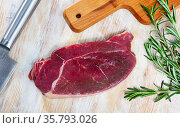 Raw horsemeat fillet with rosemary. Стоковое фото, фотограф Яков Филимонов / Фотобанк Лори