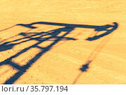 Oil pump shadow on dry ground. Oil and gas industry. Ecological problems... Стоковое фото, фотограф Zoonar.com/BASHTA / easy Fotostock / Фотобанк Лори