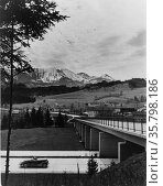 Automobile approaching overpass on the Autobahn with view of countryside... Редакционное фото, агентство World History Archive / Фотобанк Лори
