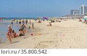 Luxurious beach on Mediterranean Sea. Wonderful and comfortable holiday. Tel Aviv (2019 год). Редакционное фото, фотограф Валерия Попова / Фотобанк Лори