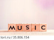 Music sign created with cubes on a wooden table. Стоковое фото, фотограф Zoonar.com/Kasper Nymann / age Fotostock / Фотобанк Лори