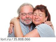 Zwei Senioren beim Kuscheln schmiegen die Wangen aneinander. Стоковое фото, фотограф Zoonar.com/Robert Kneschke / age Fotostock / Фотобанк Лори