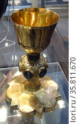 Chalice. Siena; Italy; made with copper and gold. A chalice is used during the Eucharist or Holy Communion; to hold wine. (2014 год). Редакционное фото, агентство World History Archive / Фотобанк Лори