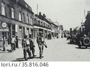 Photograph of a motor-cycle detachment passing the Belgian frontier. Редакционное фото, агентство World History Archive / Фотобанк Лори