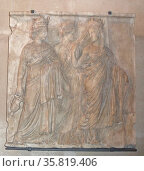 Marble relief of three Tyches (Goddesses of Fortune). Редакционное фото, агентство World History Archive / Фотобанк Лори