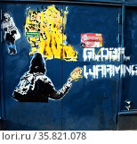 Graffiti against global warming, on a shop front in Amsterdam, Holland. Редакционное фото, агентство World History Archive / Фотобанк Лори