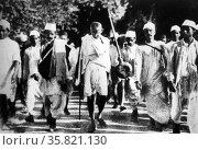 Gandhi leads a group of protesters during the Salt March, also mainly known as the Salt Satyagraha, began with the Dandi March on March 12, 1930, Редакционное фото, агентство World History Archive / Фотобанк Лори