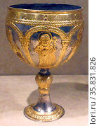 Medieval Chalice, Silver with gilding showing a youthful Christ. Редакционное фото, агентство World History Archive / Фотобанк Лори