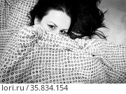 Young woman in the bed in bright light. Стоковое фото, фотограф Zoonar.com/Oliver Sved / age Fotostock / Фотобанк Лори
