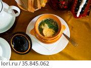 Fish soup with herbs in a pot. Стоковое фото, фотограф Яков Филимонов / Фотобанк Лори