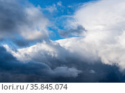 Dramatic thunderstorm clouds floating in blue sky before rain. Majestic cloudscape background. Стоковое фото, фотограф А. А. Пирагис / Фотобанк Лори