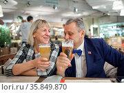 An elderly couple enjoying their beer in a cafe. Стоковое фото, фотограф Zoonar.com/Danil Roudenko / age Fotostock / Фотобанк Лори
