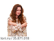 Young beautiful woman in a light dress wrapped her arms around herself as if she were chilly, isolated on white background. Стоковое фото, фотограф Евгений Харитонов / Фотобанк Лори