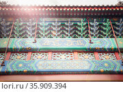 Ornate facade and roof of Chinese building. Стоковое фото, агентство Ingram Publishing / Фотобанк Лори