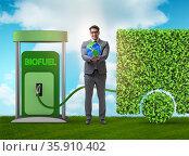Man in ecofuel concept for delivery vehicles. Стоковое фото, фотограф Elnur / Фотобанк Лори