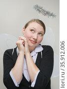 Office worker dressed as an angel. Стоковое фото, фотограф Shannon Fagan / Ingram Publishing / Фотобанк Лори
