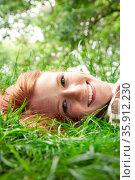 Teenage girl laying in grass. Стоковое фото, фотограф Shannon Fagan / Ingram Publishing / Фотобанк Лори