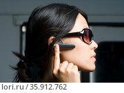 Woman wearing headset. Стоковое фото, фотограф Shannon Fagan / Ingram Publishing / Фотобанк Лори