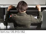 Businesswoman looking through cupboard. Стоковое фото, фотограф Shannon Fagan / Ingram Publishing / Фотобанк Лори