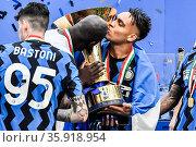 Lautaro Martinez and Romelu Lukaku (Inter) celebrate with the Serie... Редакционное фото, фотограф Nicola Marfisi / AGF/Nicola Marfisi / AGF / age Fotostock / Фотобанк Лори