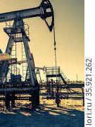 Oil pumpjack, industrial equipment. Rocking machines for power generation... Стоковое фото, фотограф Zoonar.com/BASHTA / easy Fotostock / Фотобанк Лори