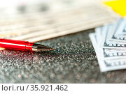 Business and financial background with dollars and pen. Economy trends... Стоковое фото, фотограф Zoonar.com/BASHTA / easy Fotostock / Фотобанк Лори