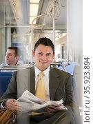 Businessman on train. Стоковое фото, фотограф Shannon Fagan / Ingram Publishing / Фотобанк Лори