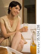 Woman with glass of orange juice. Стоковое фото, фотограф Shannon Fagan / Ingram Publishing / Фотобанк Лори