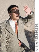 Businessman in the desert. Стоковое фото, фотограф Shannon Fagan / Ingram Publishing / Фотобанк Лори