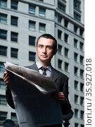 Businessman with newspaper. Стоковое фото, фотограф Shannon Fagan / Ingram Publishing / Фотобанк Лори