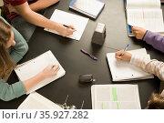 Four students working in a classroom. Стоковое фото, фотограф Shannon Fagan / Ingram Publishing / Фотобанк Лори